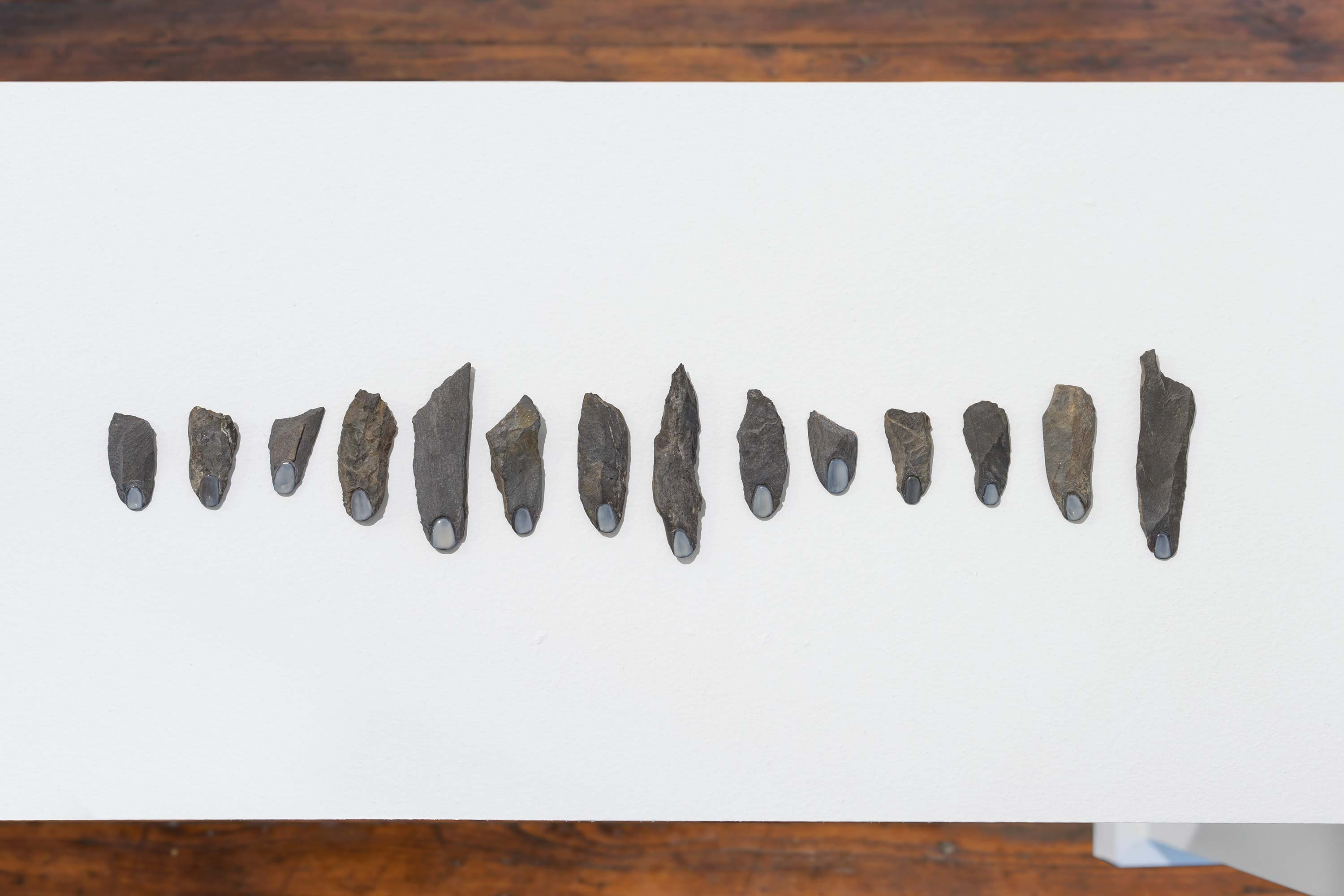 Kylie Lockwood<br>Stone Fingers<br>2013<br>River stone and nail polish<br>dimensions variable